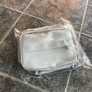 Large silver makeup bag